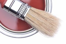 Top view of red paint can with brush isolated on white backgroun