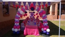 Monkey Magic pink purple and white themed event with balloon arch way