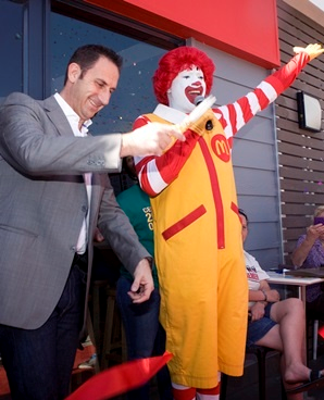 McDonald's SA CEO Greg Solomon kicks off the 20th birthday celebrations in SA with Ronald McDonald. (Supplied)